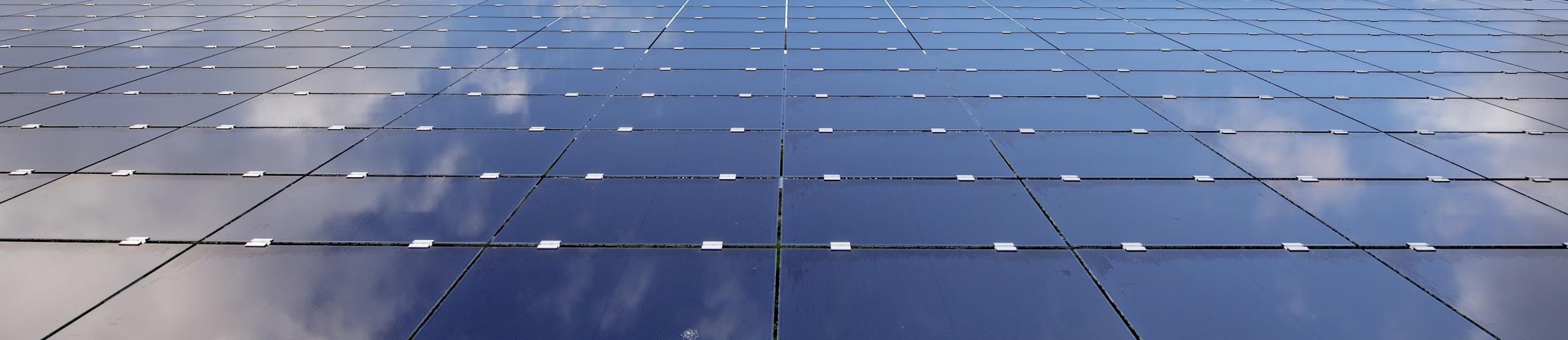 Solar panels reflecting sky