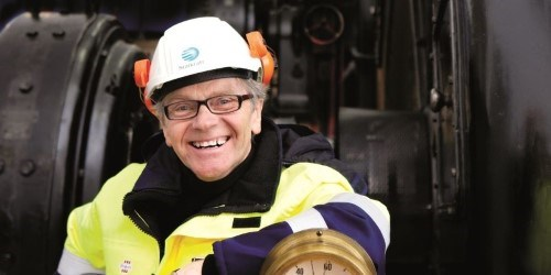 Smiling Statkraft employee with helmet