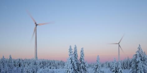 Wind mills in forest in winter