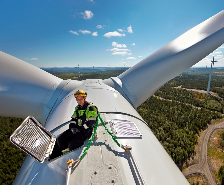 Man on the top of a wind turbine